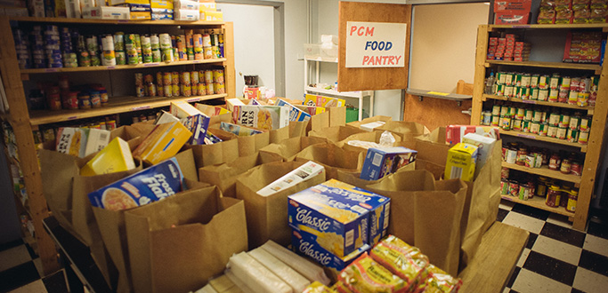 A picture of a food pantry full of bags