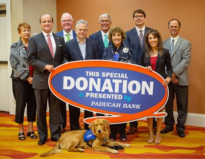 Photo of the Paducah Bank Board of Directors with Walker Paws with Purpose